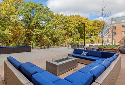Bell Olmsted Park apartments firepit with seating